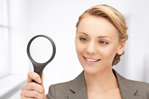 Woman Holds a Magnifying Glass