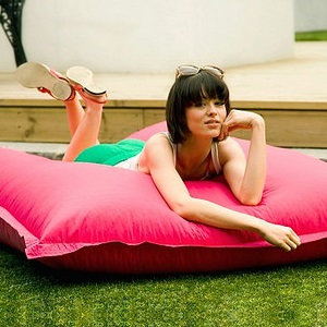 woman lies on a beanbag