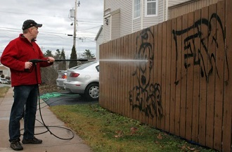 cleaning graffiti from a house